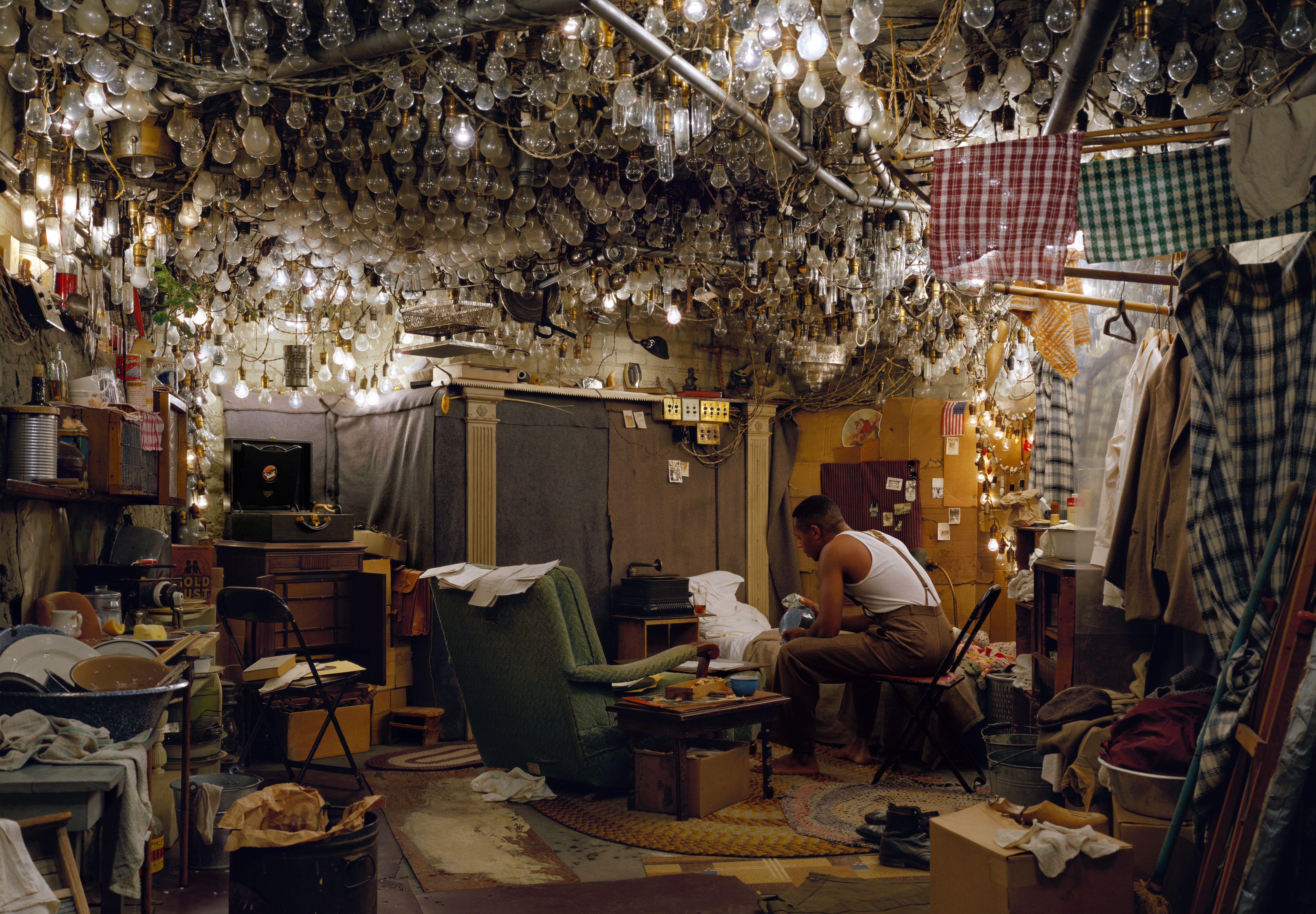 """Jeff Wall, After """"Invisible Man"""" by Ralph Ellison, the Prologue, 1999-2001 Transparency in lightbox, 174 x 250,5 cm courtesy the artist © Jeff Wall"""